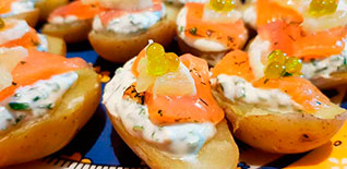 Potato with salmon and olive oil pearls' tapa